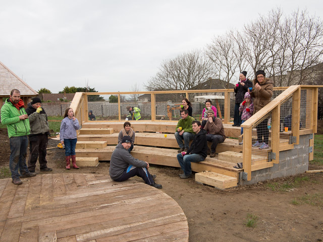 The structure of the outdoor classroom and some gardeners